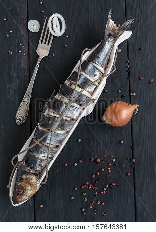 Salted Herring, Onion, Pepper And Fork.