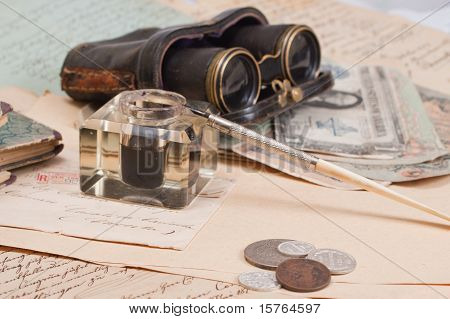 Vintage Background With Old Paper, Old Ink Pen, Handwrite Letters, Binoculars And Old Ink Pot
