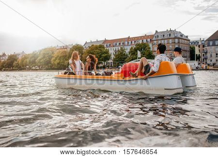 Group Of People Enjoying Boating In The Lake