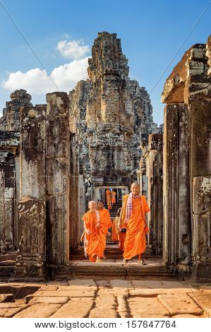 Young Buddhist Monks Coming Out Of Bayon Temple In Angkor Thom
