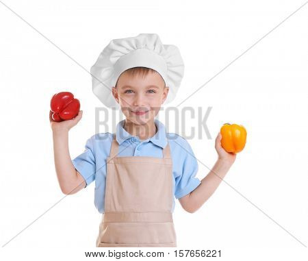 Little boy in chef hat on white background