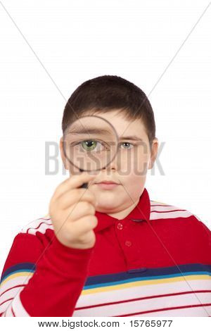 Boy Looking Through A Magnifying