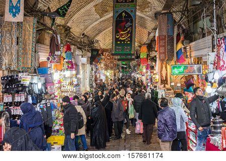 Tehran, Iran - December 7, 2015: Iranian people shopping in Grand Bazaar in Tehran, Iran