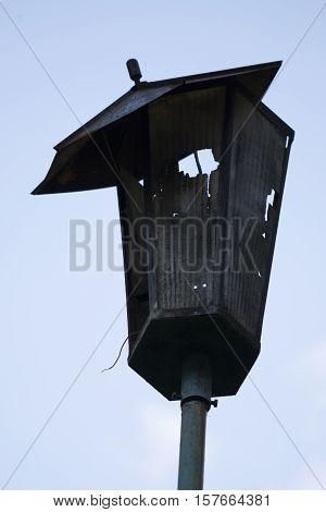 Broken hooligans street lamp background, bankruptcy, blue