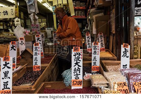 Tokyo, Japan - December 8, 2015: Various kinds of beans: azuki, soybeans, black beans, white kidney beans, and much more for sale at Tsukiji Fish Market