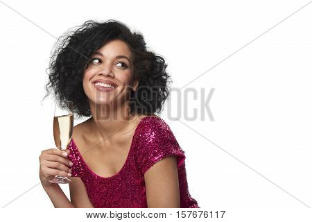 Party, drinks, holidays and celebration concept. Closeup happy playful laughing mixed race woman in sequined dress with glass of champagne looking to the side at blank copy space