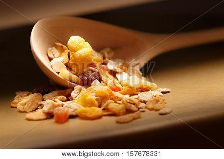 Heap Of Musli With Raisin In Wooden Spoon