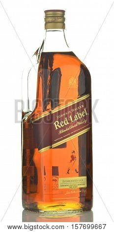 CIRCA NOVEMBER 2016 - GDANSK: Johnnie Walker Red Label blended whisky isolated on white background. Johnnie Walker was established in 1820 in Kilmarnock, Scotland.