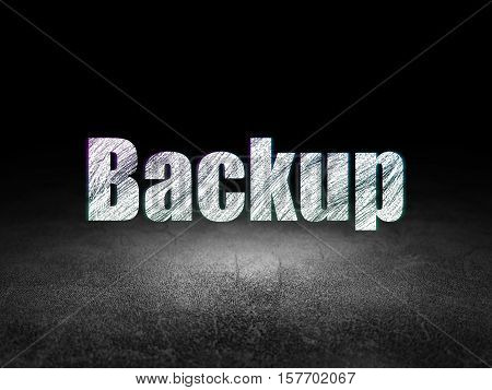 Programming concept: Glowing text Backup in grunge dark room with Dirty Floor, black background