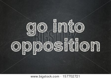 Politics concept: text Go into Opposition on Black chalkboard background