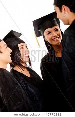 Group of graduates wearing a gown and mortarboard talking- isolated
