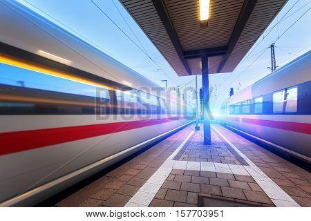 High Speed Passenger Trains On Railroad Platform In Motion