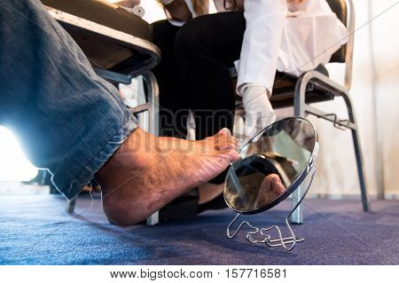 Rio de Janeiro Brazil - november 14 2016: Health professional teaches patient to look at foot for diabetic foot detection during World Diabetes Day event