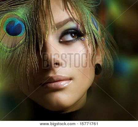 Beautiful Fashion Girl face.Peacock Makeup