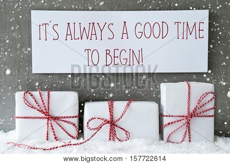 Three Christmas Presents On Snow. Cement Wall As Background With Snowflakes. Modern And Urban Style. Card For Birthday Or Seasons Greetings. Label With English Quote It Is Always A Good Time To Begin