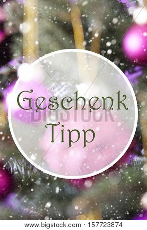 German Text Geschenk Tipp Means Gift Tip. Vertical Christmas Tree With Rose Quartz Balls. Close Up Or Macro View. Christmas Card For Seasons Greetings. Snowflakes For Winter Atmosphere.