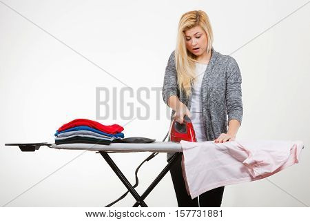 Woman Having Enough Of Ironing Clothes