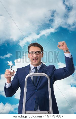Businessman with star award against sky