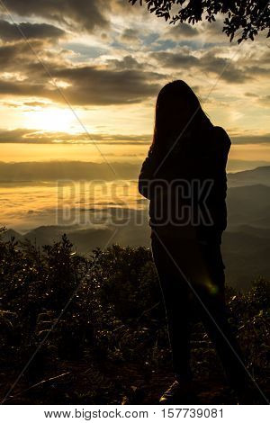 Silhouette with Thai woman at doi dam, wianghaeng chiangmai Thailand
