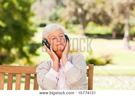 Senior woman listening to some music