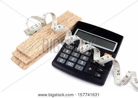 Measuring tape, calculator and pieces of crispbread isolated on white background. A symbol of diet