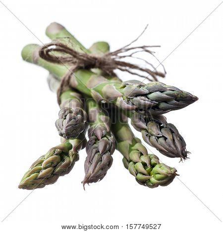 Extreme close-up image of fresh asparagus on white background