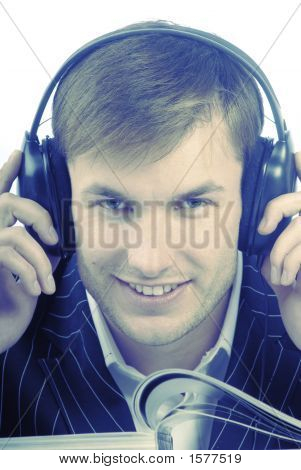 Portrait, Businessman With Pleasure Listens To Music