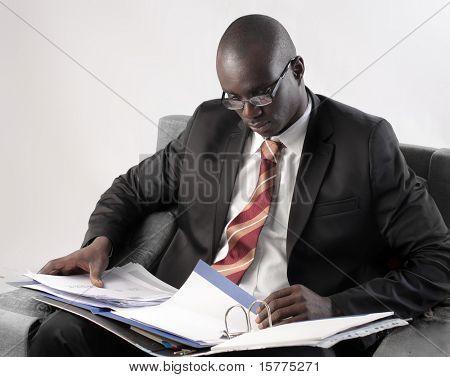 African businessman folding a copybook