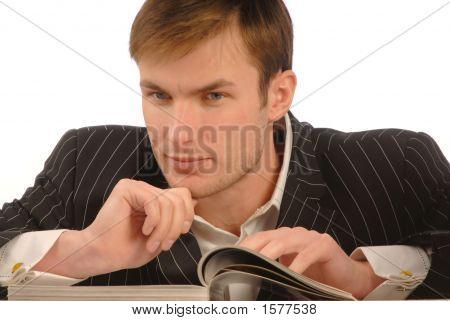 Businessman Looks Magazine, Close Up