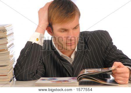 Businessman Looks Magazine