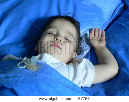 Sleeping Baby And A Pacifier
