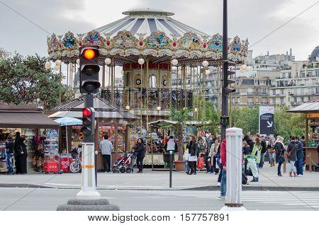 PARIS, FRANCE - NOVEMBER 14, 2013: Parisian colorful carousel