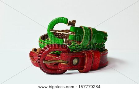 Christmas theme color leather woven belt on white background