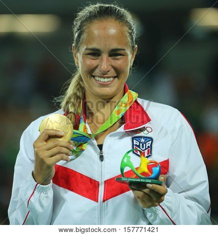RIO DE JANEIRO, BRAZIL - AUGUST 13, 2016: Olympic champion Monica Puig of Puerto Rico during medal ceremony after victory at tennis women's singles final of the Rio 2016 Olympic Games