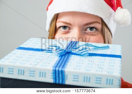 Young Woman In Santa Hat With Gift