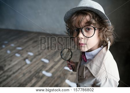 Little detective with a magnifying