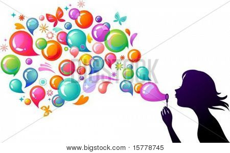 Young girl blowing soap bubbles