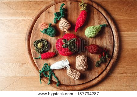 Crochet vegetables on a wooden board - eco toys or kitchen decor