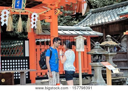 Kyoto,Japan-June 26,Tourists listen to music, share the love,within Fushimi Inari shrine on June 26,2016 in Kyoto,Japan.
