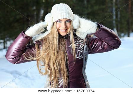 Beautiful young woman in winter clothes outdoor.