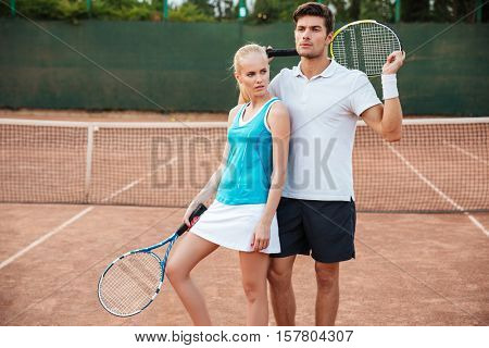 Young tennis models on court