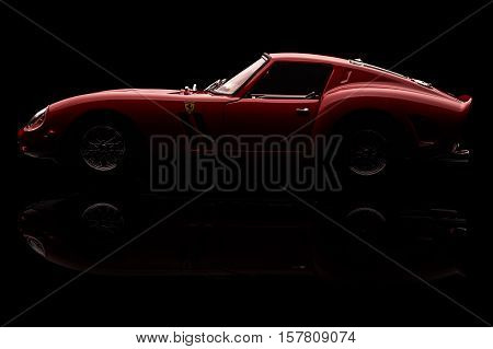 KRIVOY ROG, UKRAINE - OCT 29 - Toy Ferrari 250 GTO on background. Photo made in the studio, Saturday 29 October 2016