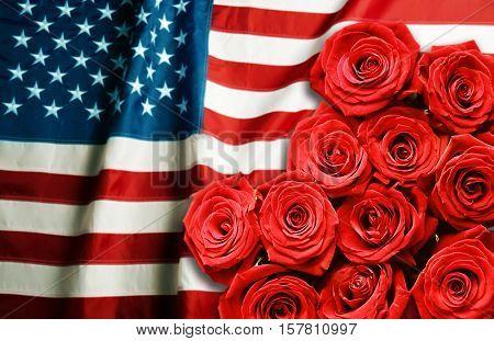 Roses on USA flag background. Symbol of America