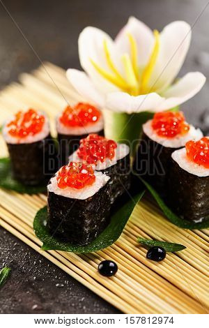 Ikura Maki Sushi - Roll with Cream Cheese inside. Topped with Ikura (Salmon Roe)