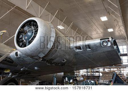 DAYTON, OHIO, USA-NOVEMBER 18, 2016:National Museum USAF is restoring famousoriginal WWII Memphis Belle B-17F Flying Fortress bomber left radial engine & partial wing shown here in restoration hanger.