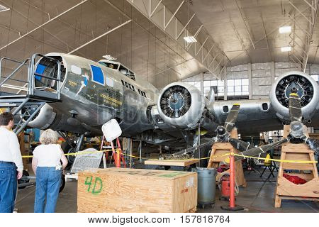 DAYTON, OHIO, USA - NOVEMBER 18, 2016: National Museum USAF is restoring the famous original WWII Memphis Belle B-17F Flying Fortress bomber, shown here in Behind the Scenes Tour in restoration area.
