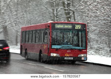 London, UK, January, 20 2013: London Transport red bus on its route towards Clapham Junction during a heavy snow blizzard