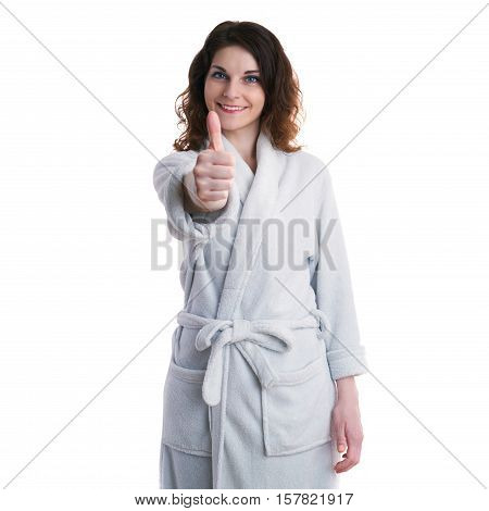 Smiling young woman in bath robe over white isolated background showing thump up sign, morning, healthy, relaxation and beauty concept