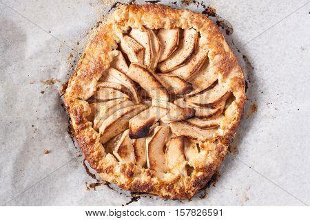 homemade fresh apple galette, apple tart on parchment paper