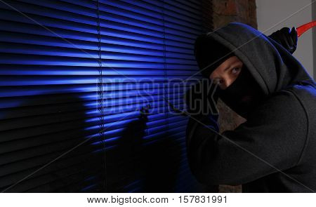 Robber trying open window night